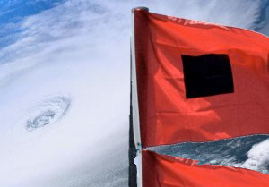 Hurricane warning flag with satellite image of a hurricane in the background