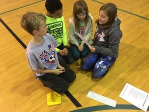Students participate in a Health Rocks activity at a local school.