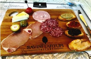 Photo of charcuterie board with truffle infused items.