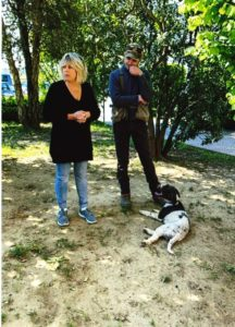Photo of Sandra Rosy Lotti owner of the Toscana Saporita Cooking School visiting Savini Tartufi, Italy. Shown with Savini family member and one of their truffle dogs.