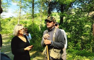 Photo of Linda Jendro and other on tour with Savini family member in nearby woods during a truffle hunt.