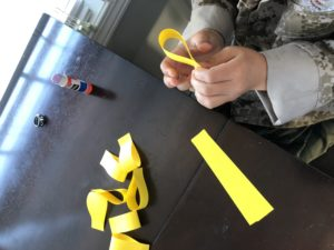 Gluing strips of paper together