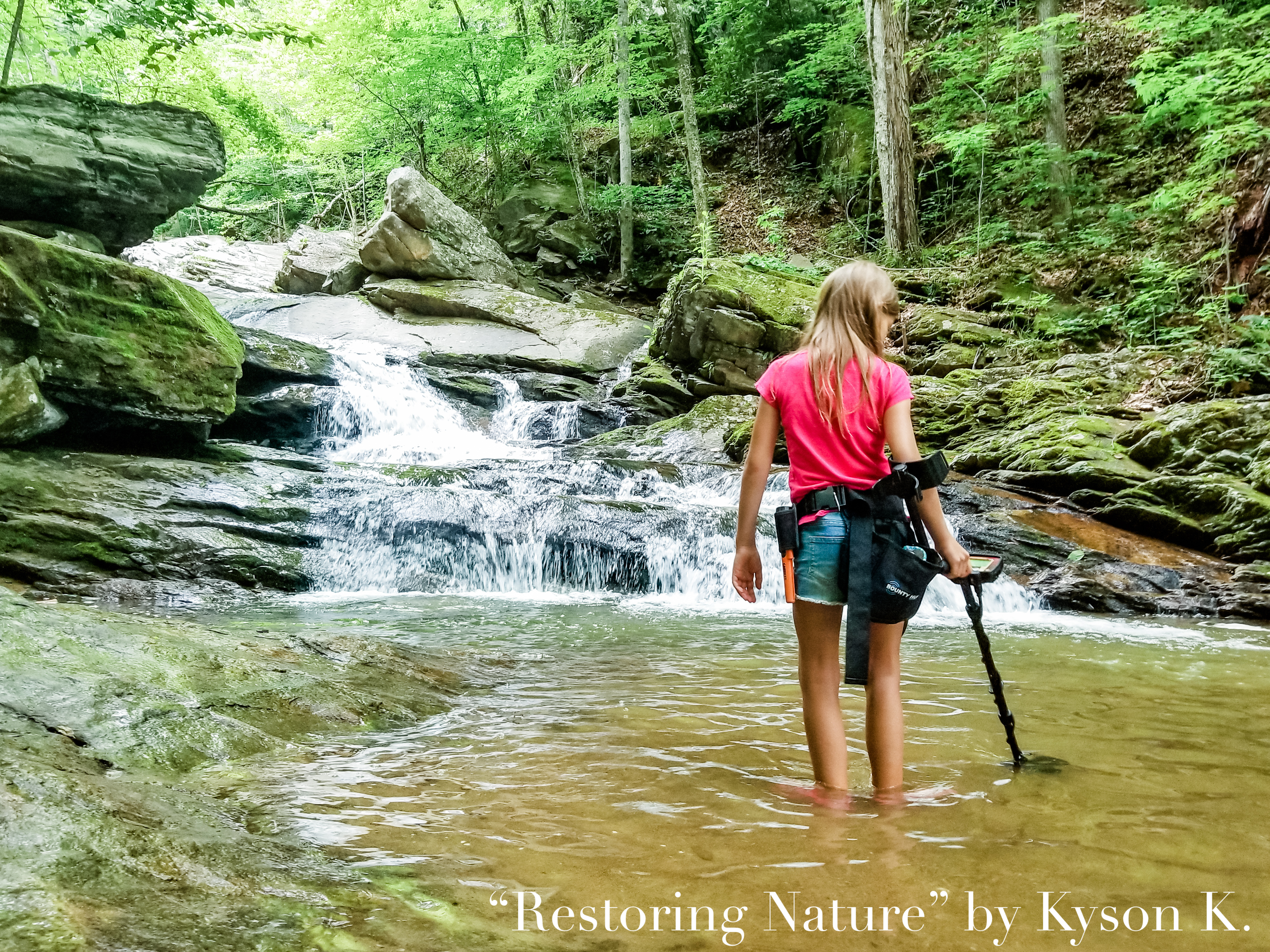 """2020 1st place Intermediate Division: 4-H in Action """"Restoring Nature"""" taken by Kyson K."""