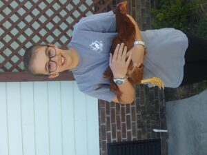 Bethany C. holding a chicken from Poultry Project