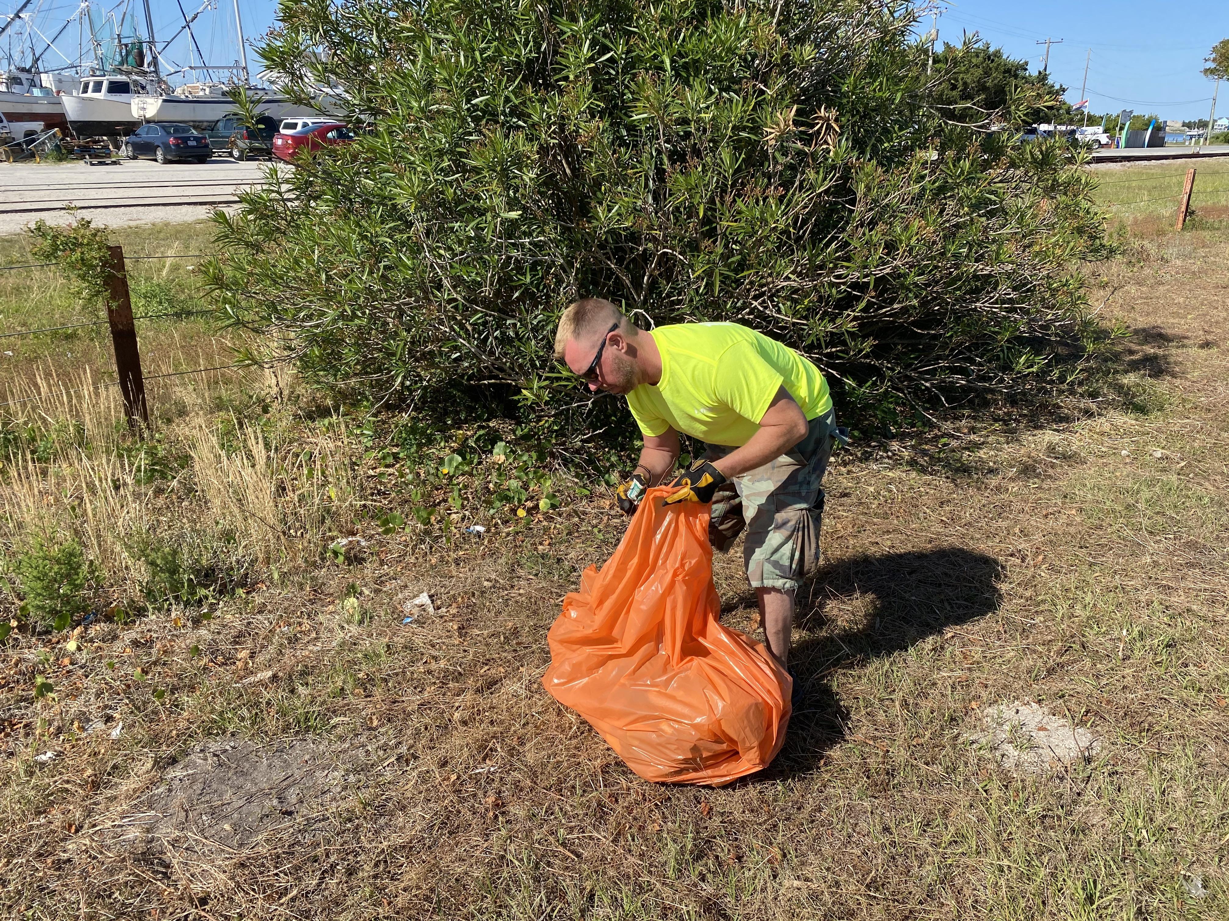 Volunteer picking up trash.