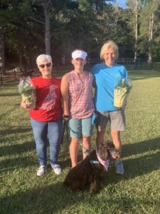 Judges Rosey Ward and Terry Murphy, pictured with 4-H'er Bethany Copeland and her dog, Melody